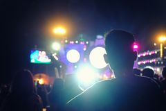 Defocused entertainment concert lighting on stage, blurred disco. Party and Concert Live, Crowded event with people clapping in front of a stage royalty free stock photography