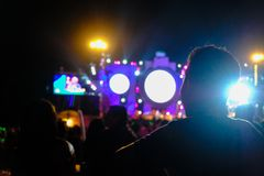 Defocused entertainment concert lighting on stage, blurred disco. Party and Concert Live, Crowded event with people clapping in front of a stage stock photos