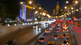 Defocused and fast video. Cars on the road out of the tunnel in the city center. stock footage