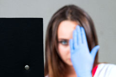 Defocused female doctor, nurse, close up, close my eyes looking. At the sign checking vision, with space for text Royalty Free Stock Photography