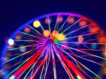 Defocused ferris wheel with colorful lights Stock Photo