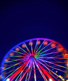 Defocused ferris wheel with colorful lights. Blur abstract background ready for your design Stock Photography