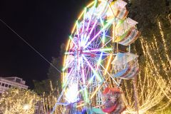 Defocused ferris wheel with colorful lights, Blur abstract background ready for your design stock photos