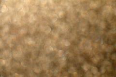 Golden Background. Defocused festive glitter background. Golden shiny bokeh royalty free stock photos