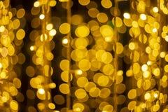 Defocused Festive Golden Lights Bokeh. Christmas lights, Abstract background of festive light bokeh stock photos