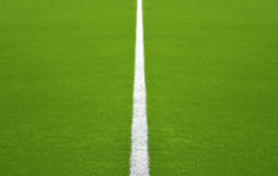 Defocused football / soccer field with White central line Royalty Free Stock Images