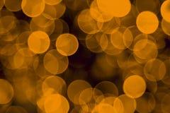 Defocused gelbe Leuchte-Feiertags-Hintergrund Lizenzfreie Stockfotografie