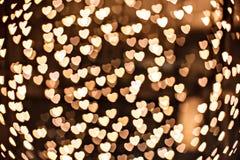 Defocused gele fonkelingen - gouden hart stock foto