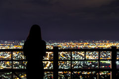 Defocused Girl and city light Royalty Free Stock Images