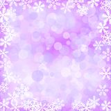 Defocused glitter background with snowflakes Royalty Free Stock Images