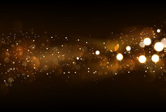 Defocused glitter lights background in dark gold and black color. S Stock Images