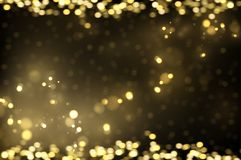 Sparkling golden particles on dark royalty free stock images
