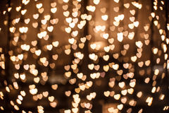 Defocused gold heart in technique bokeh. Defocused yellow sparkles - gold heart Stock Photos