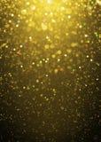 Defocused gold sparkle glitter lights background Stock Images