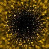 Defocused gold sparkle glitter lights background Royalty Free Stock Photo