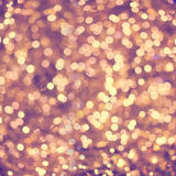 Defocused golden abstract christmas background with bokeh effect Royalty Free Stock Photography