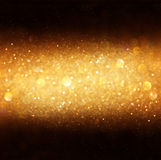 Defocused golden bokeh light. Royalty Free Stock Images