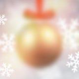 Defocused golden christmas ball. Stock Photos