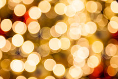 Defocused Golden Christmas Bokeh lights. Stock Images