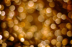 Defocused golden holiday background Stock Photos