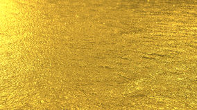 Defocused golden toned water surface texture background Royalty Free Stock Images