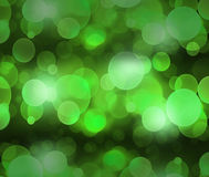 Defocused green light dots against background Stock Photography