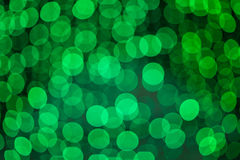 Defocused green lights abstract background photo Royalty Free Stock Images