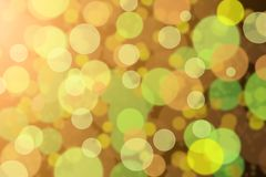 Defocused green and orange bokeh. Background Stock Photo