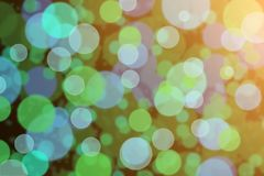 Defocused green and purple bokeh. Background Royalty Free Stock Images