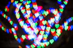Defocused hearts background. Blur heart bokeh Stock Photos