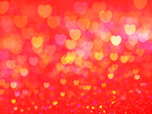 Defocused illuminated hearts background Stock Photo