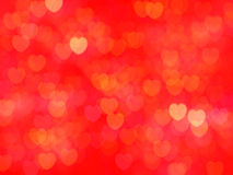 Defocused illuminated hearts background Royalty Free Stock Image