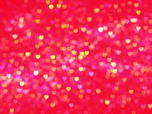 Defocused illuminated hearts background Stock Images