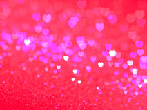 Defocused illuminated hearts background Royalty Free Stock Images