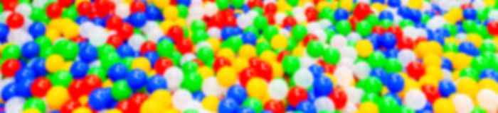 Defocused image. Abstract background. Colorful plastic balls Stock Photography