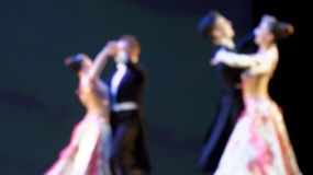 Defocused image of dancing people Stock Photos