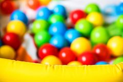 Close up blurred ball pit for kids stock image