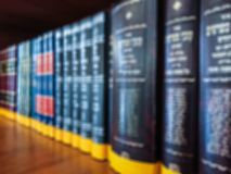 Defocused image. Multi-colored books on the bookshelf in the library. The bokeh effect Stock Image
