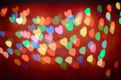 Defocused Lichter bokeh Hintergrund von rosa Herzen Lizenzfreie Stockfotografie