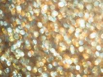 Defocused Lichter des Gold-bokeh Zusammenfassungs-Hintergrundes, Beschaffenheitstapete Stockbilder