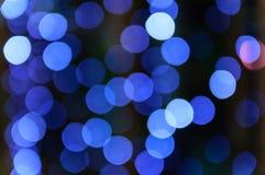 Defocused light. Blue light bokeh backgrounds at night Royalty Free Stock Image
