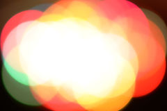 Defocused lights. Out of focus colorful lights merged in white space in the middle Royalty Free Stock Images
