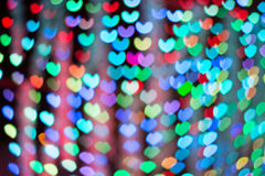 Defocused lights background. Heart bokeh. Bright colorful heart bokeh background. Multicolored blurry hearts on a black background royalty free stock photo