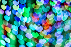 Defocused lights background. Heart bokeh. Bright colorful heart bokeh background. Multicolored blurry hearts on a black background royalty free stock image