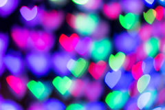 Defocused lights background. Heart bokeh. Bright colorful heart bokeh background. Multicolored blurry hearts on a black background royalty free stock photography