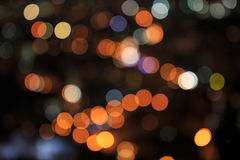 Defocused lights of big city in night time. Defocused lights and building of big city in night time Royalty Free Stock Photo