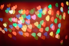 Defocused lights bokeh background of pink hearts Royalty Free Stock Photography