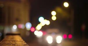 Defocused lights of cars in night city. Urban traffic blurred shot stock video