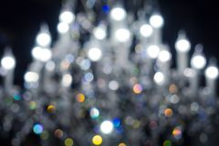 Defocused lights of chandelier, blurred light fixture background stock photography