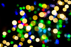 Defocused lights from christmas decorations. Abstract background Stock Photos